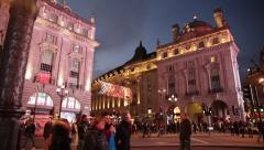 Piccadilly Circus: wide angle tilt: beautifully lit place, London, Europe Stock Footage