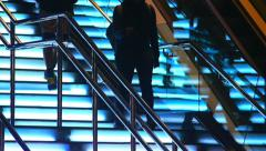 Stock Video Footage of Urban night scene with modern architecture details with people walking on stairs