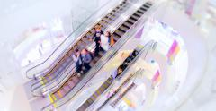 Loopable video of people moving fast on escalators in modern shopping mall Stock Footage