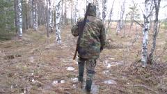 Hunter goes to the marsh. - stock footage