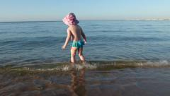 Little girl first time on the sea shore. Stock Footage