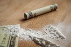Dollars and cocaine Stock Photos
