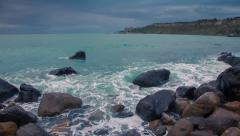 Waves washed coastal stones at spring day Stock Footage