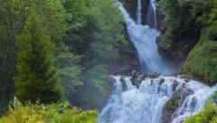 Beautiful waterfall shrouded fresh leaves - stock footage