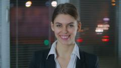 The young businesswoman smiles in the camera broadly Stock Footage