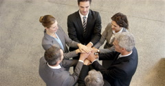 Happy business people putting hands together Stock Footage