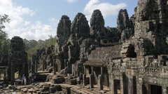 Bayon temple in Agnkor Thom with tourists,Siem Reap,Cambodia Stock Footage