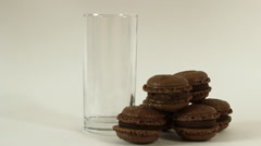 Chocolate macaroon and pouring milk on white background Stock Footage