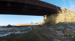 River flowing under the bridge. Stock Footage