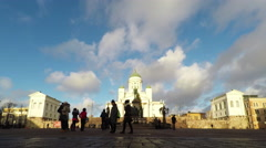 Stock Video Footage of HELSINKI, FINLAND - DECEMBER 25, 2015: People enjoy a sunny day in the Senate Sq
