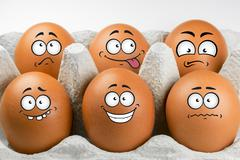 Eggs with faces and various expressions. - stock photo