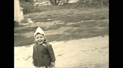 Vintage 16mm film, 1948, rural America, happy little boy play on property Stock Footage