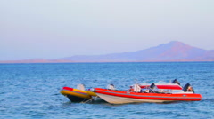 Boats wallow Red Sea, Egypt, Sharm El Sheikh Stock Footage