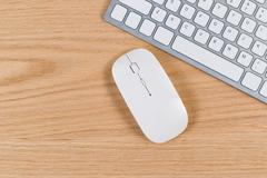 Clean desktop with keyboard and mouse on red oak surface Stock Photos