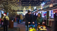 Kiev, Ukraine, December 25, 2015:  Happy people in Christmas market. Timelapse Stock Footage