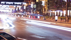 Kiev, Ukraine, December 25, 2015: cars go on brightly lit street. Timelaps Stock Footage
