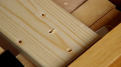 Screw being screwed into a wood - stock footage