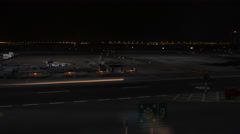 Abu Dhabi airport at night. Time lapse video Stock Footage