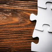 Placing missing a piece of puzzle. business concept. - stock photo