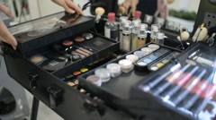 Make-up artist opens a large case with cosmetics palette - stock footage