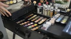 Make-up artist closes the case with a great makeup , choose the desired palette Stock Footage