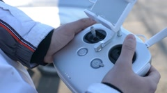 The pilot flying drone quadrocopter control it with a joystick - stock footage