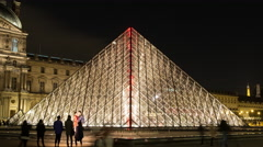Time Lapse Zoom - I. M. Pei Pyramid at Night the Louvre -  Paris France Stock Footage