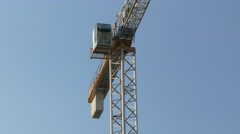 Ungraded: High Crane Carries Vat of Concrete Against Blue Summer Sky - stock footage