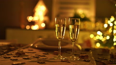 Champagne glasses on christmas table Stock Footage