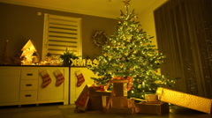 Lighted christmas tree with decoration at home Stock Footage