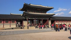 Crowd of tourists at Geunjeongmun (Inner Gate) of Gyeongbok Royal Palace Stock Footage