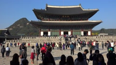 Crowd tourists in front of  the main throne hall of Gyeongbok Palace Stock Footage