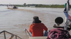 Boat on river river to Tonle Sap ,Tonle Sap,Cambodia Stock Footage