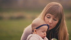 A baby being entertained with food at a family picnic on a fall day - stock footage