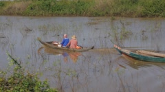 Family in small motor boat on canal,Tonle Sap,Cambodia Stock Footage