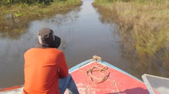 On boat through narrow canal,Tonle Sap,Cambodia Stock Footage