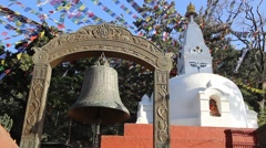 Bell on a background of a small stupa in the Monkey Temple (Kathmandu, Nepal) Stock Footage