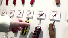 One side of people buying multiple functions knife in Coquitlam shopping mall Stock Footage