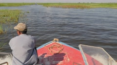 Boat on river with green grass,Tonle Sap,Cambodia Stock Footage