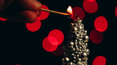 Original christmas candle set fire to a match - stock footage