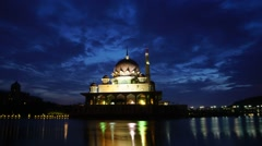 Timelapse of sunrise over Putra mosque in Putrajaya, Malaysia Stock Footage