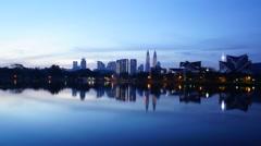Timelapse of sunrise over lake Titiwangsa in Kuala Lumpur, Malaysia Stock Footage