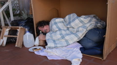 Stock Video Footage of homeless jobless sleeping in carton box
