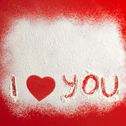 I love you sign on snowed red background Stock Photos