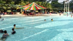Timelapse view of children fun in swimming pool Stock Footage