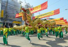 Parade of a Chinese dragon for Chinese New Year Celebrations, Thailand Stock Photos
