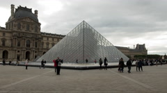 Time Lapse Zoom - I. M. Pei Pyramid  Louvre - Cloudy Daytime - Paris France - stock footage