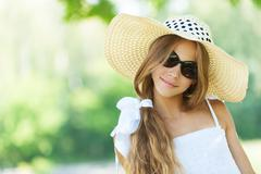 Beautiful teenage in wide-brimmed hat Stock Photos