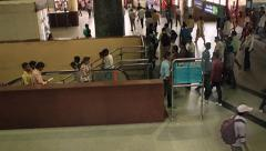 Delhi metro escalator. Passengers come up to the top of an escalator Stock Footage