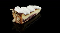 Slice of cheesecake with whipped cream - stock footage
